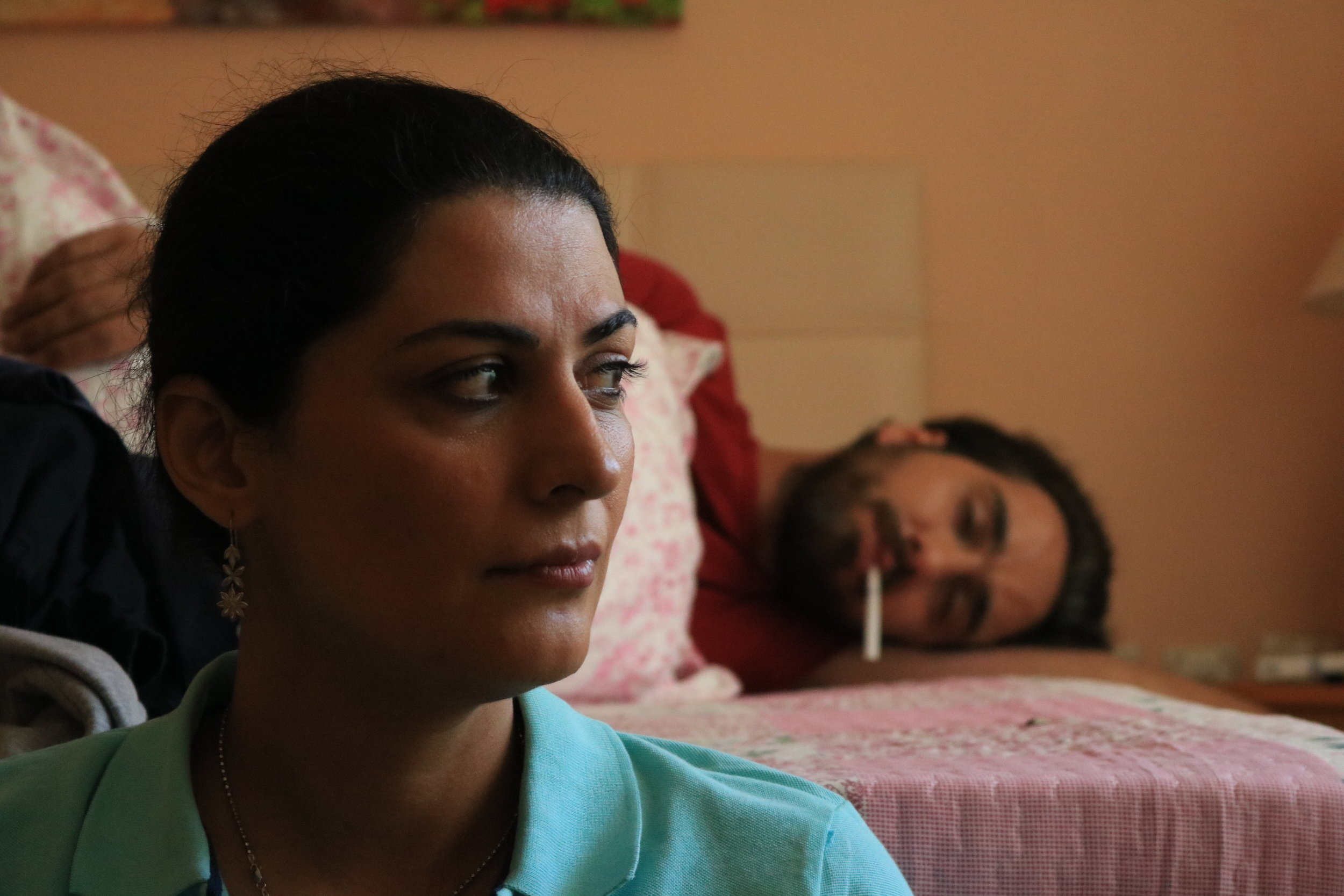 "Scene from, ""Arrested."" Actress Raana Jolghani plays a wife that cannot comfort her husband, who is left traumatized by the losses he felt after his arrest and mistreatment in prison. -"