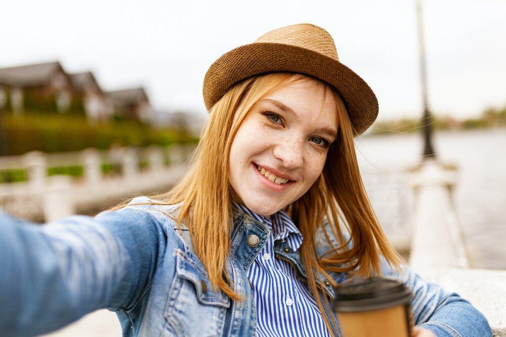 woman-taking-selfie-while-smiling-1310522.jpg