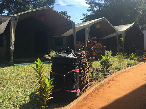 JamPac® the good looking travel backpack, roughing it out, but not without the company of the dry bag packing organiser bag VacPac! 😜 Glamping! Camping in Style!