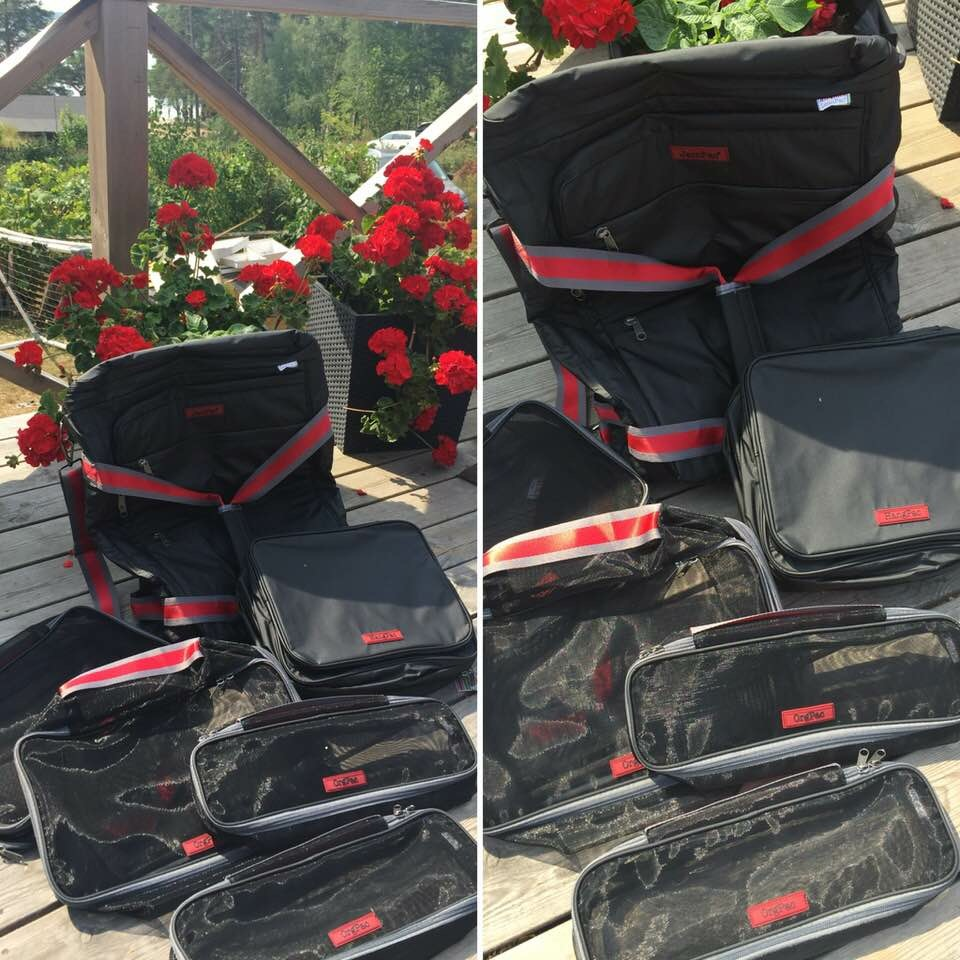 "Thanks to Catherine! Layout of the whole family in sunshine & red flowers really bring out the ""handsome"" in our products! Happy Travels! Want what Catherine have? Shop now!"