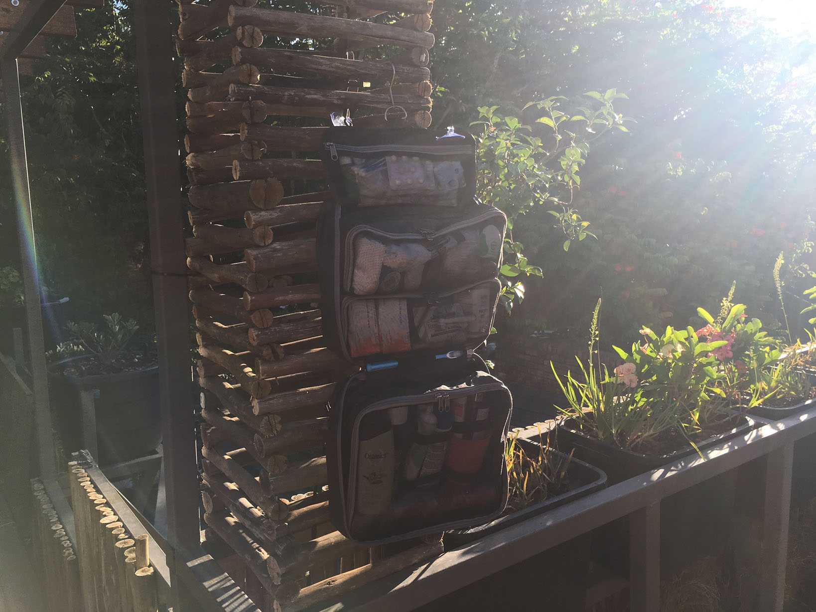 A super large hybrid overnight/toiletry bag for all situations and occasion. Check out our HangPac at an inpromtu outside bathroom getting some morning sun! Beautiful AND practical. Get yours!
