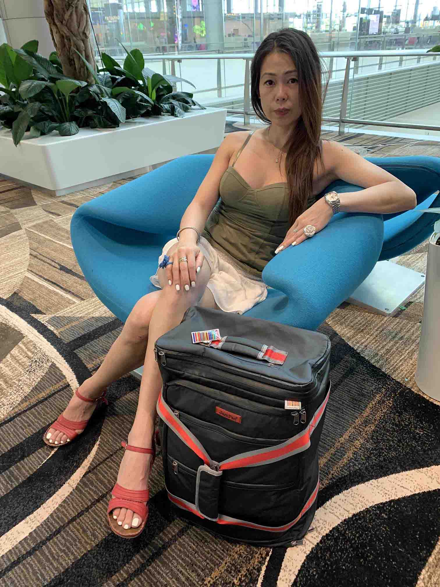 Michelle at Singapore Airport with a no compromise week's packing in the JamPac.