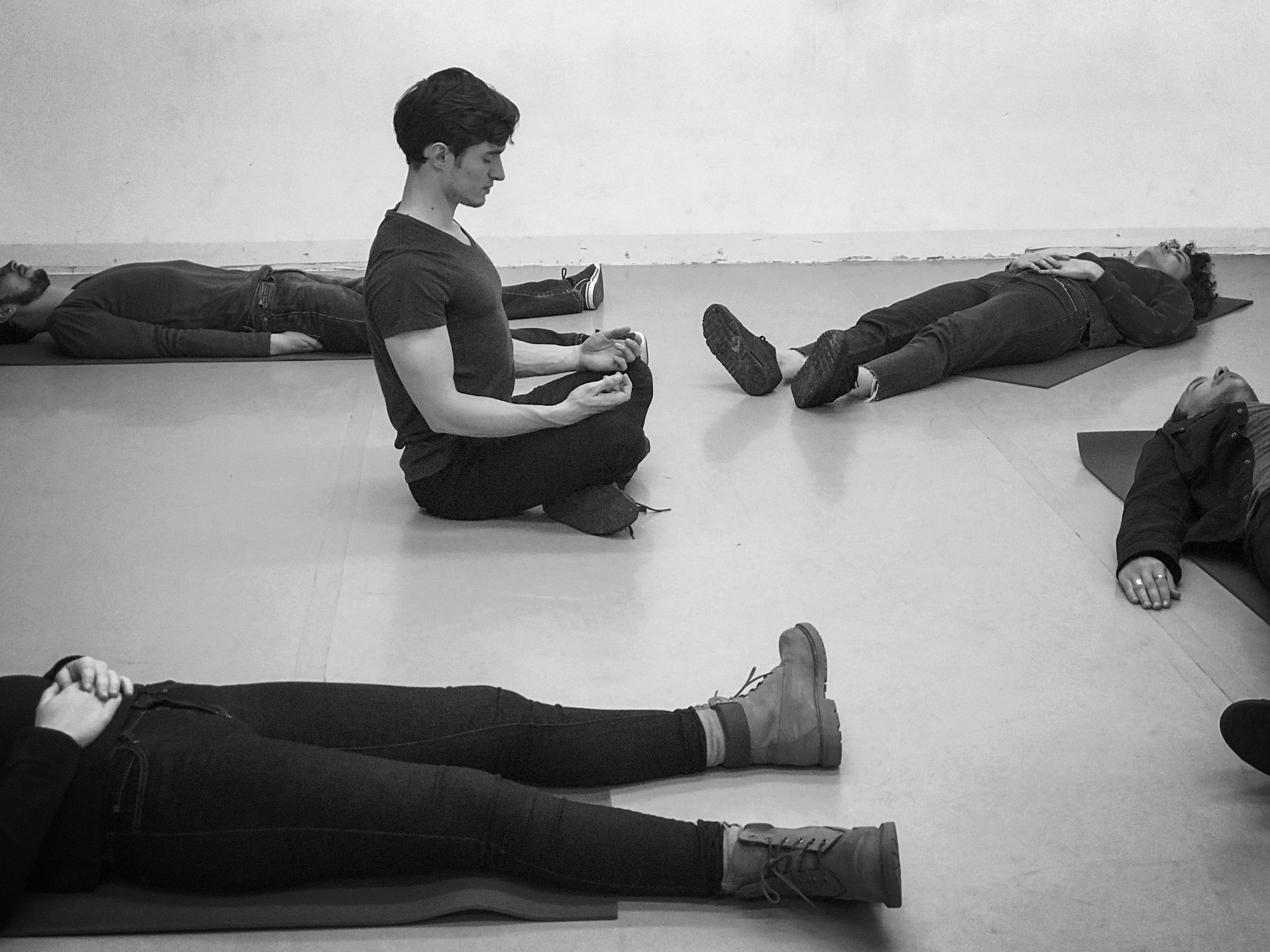 Celia leads a class through guided meditation in Paris, France.