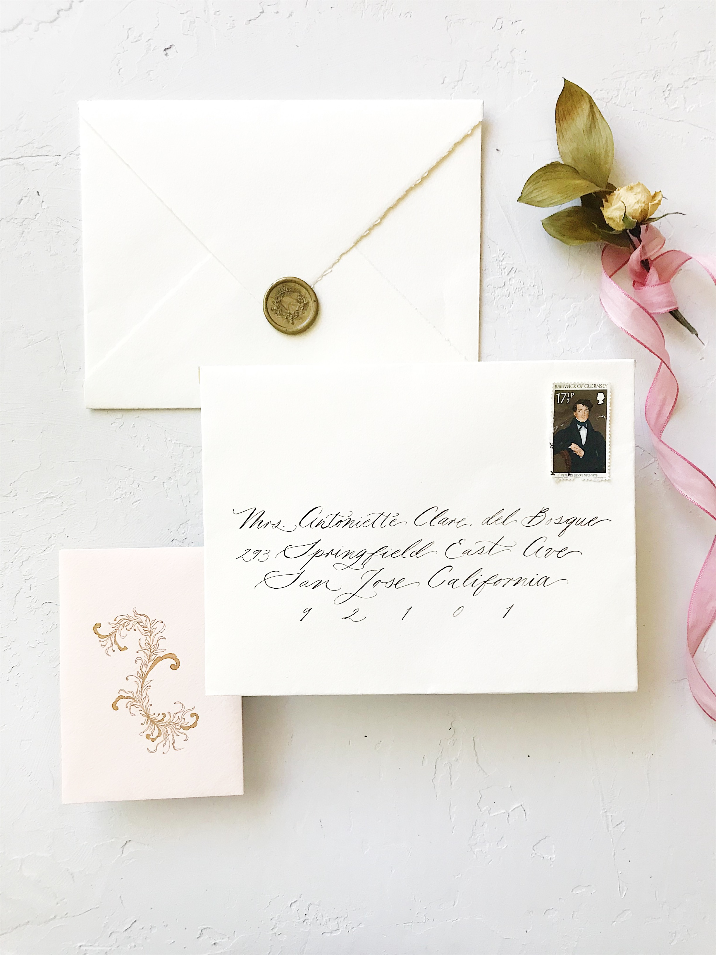 Bespoke Wedding Calligraphy Invitation Suite - Esperanza Atelier Fine Art Calligraphy. Bespoke Wedding envelope Calligraphy Houston weddings - Esperanza Atelier Fine Art Calligraphy. Houston Calligrapher. Peter Le Lievre Royal Vintage Mail Stamp (stamped on 15 November 1980) and a botanical gold wax seal.  The sepia ink goes beautifully well with the muted neutral color of the envelopes.