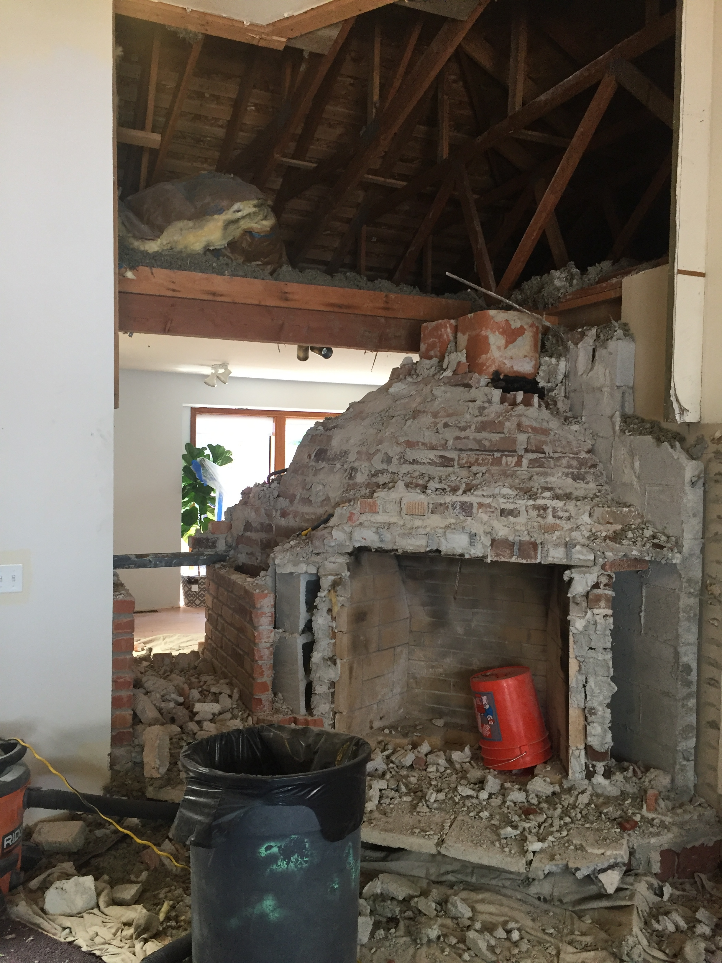 My husband first started chiseling away at it then we realized how big a job this was going to be. To remove the fireplaces, it took two guys with a roto hammer, 2 full 8 hour plus days to get it all out!     Seeing the other room made me excited!