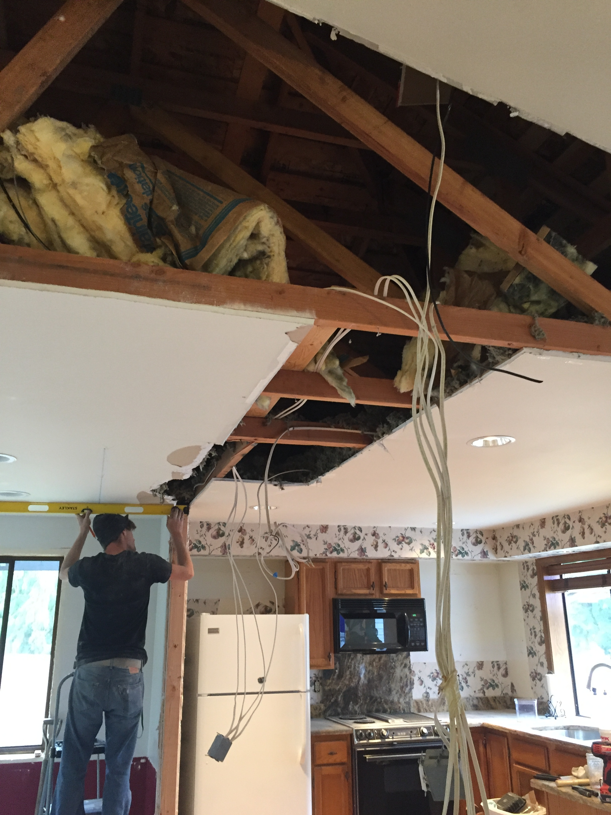 The more my contractors looked at the truss system when we opened up the ceiling, they were convinced we didn't need a post. The exterior was are the supporting walls for the roof. Not having a post was so aweseome!