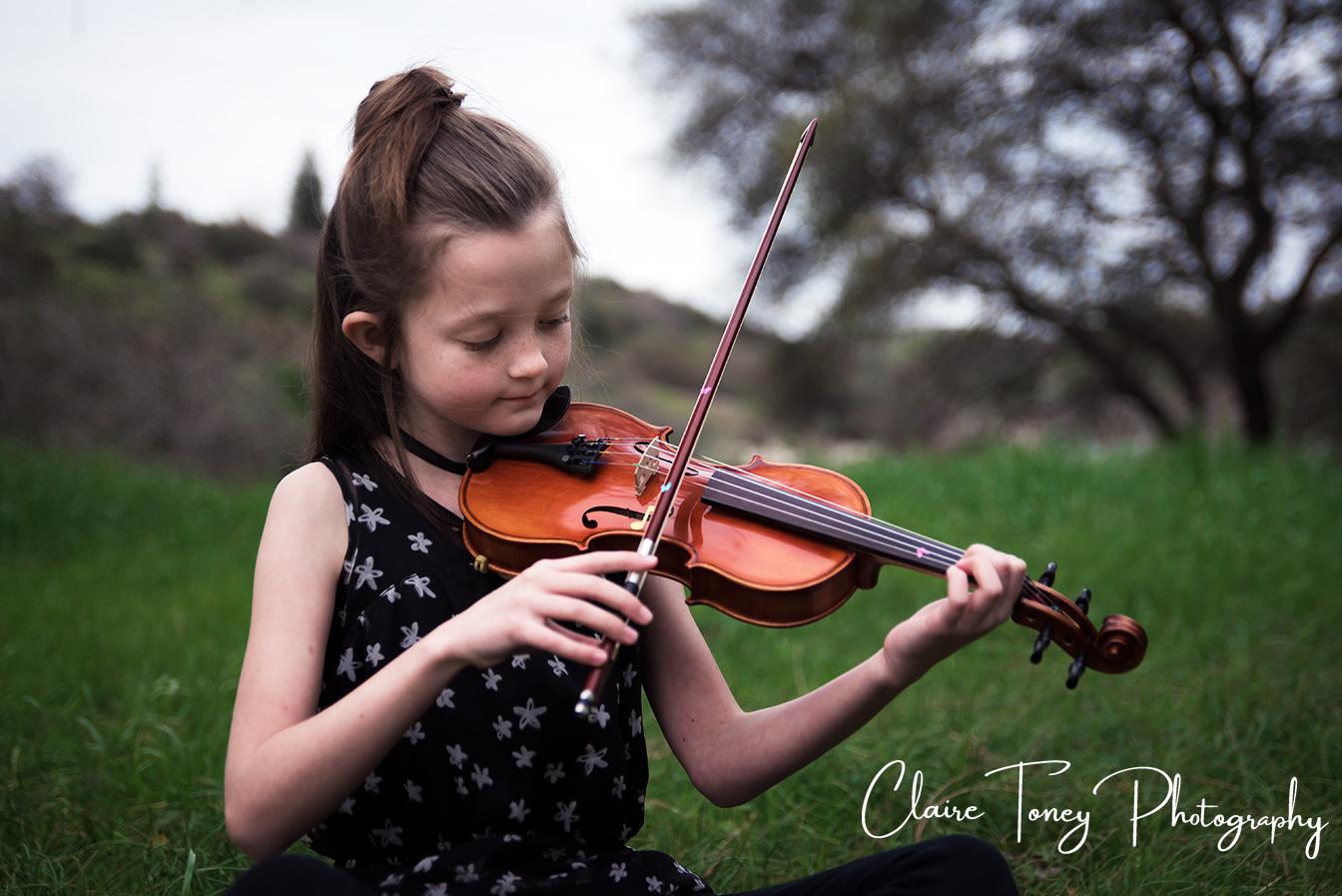 Tween girl playing a violin