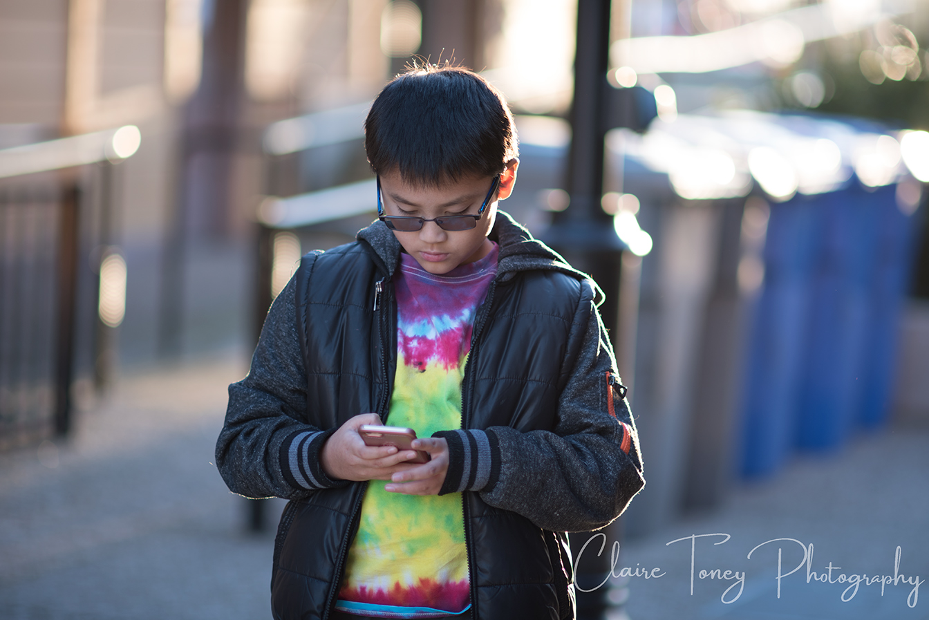 well exposed photo of boy holding a phone