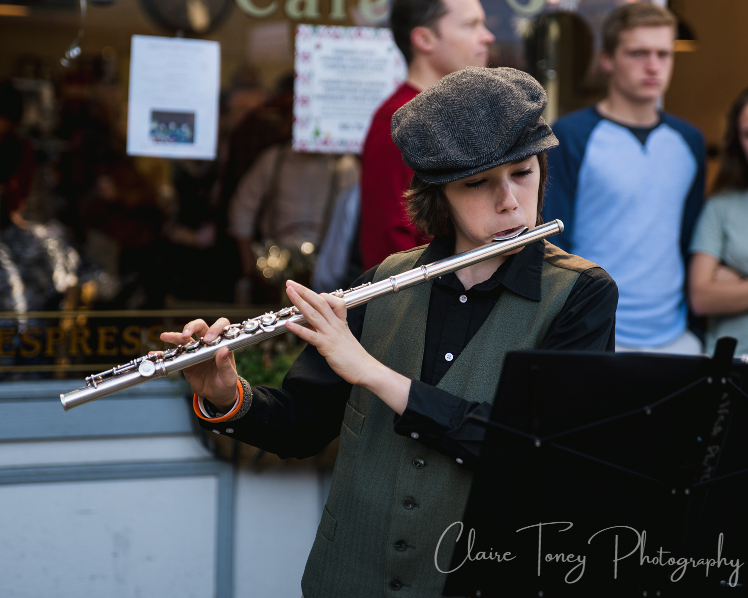 A flute player dressed in a Victorian costume