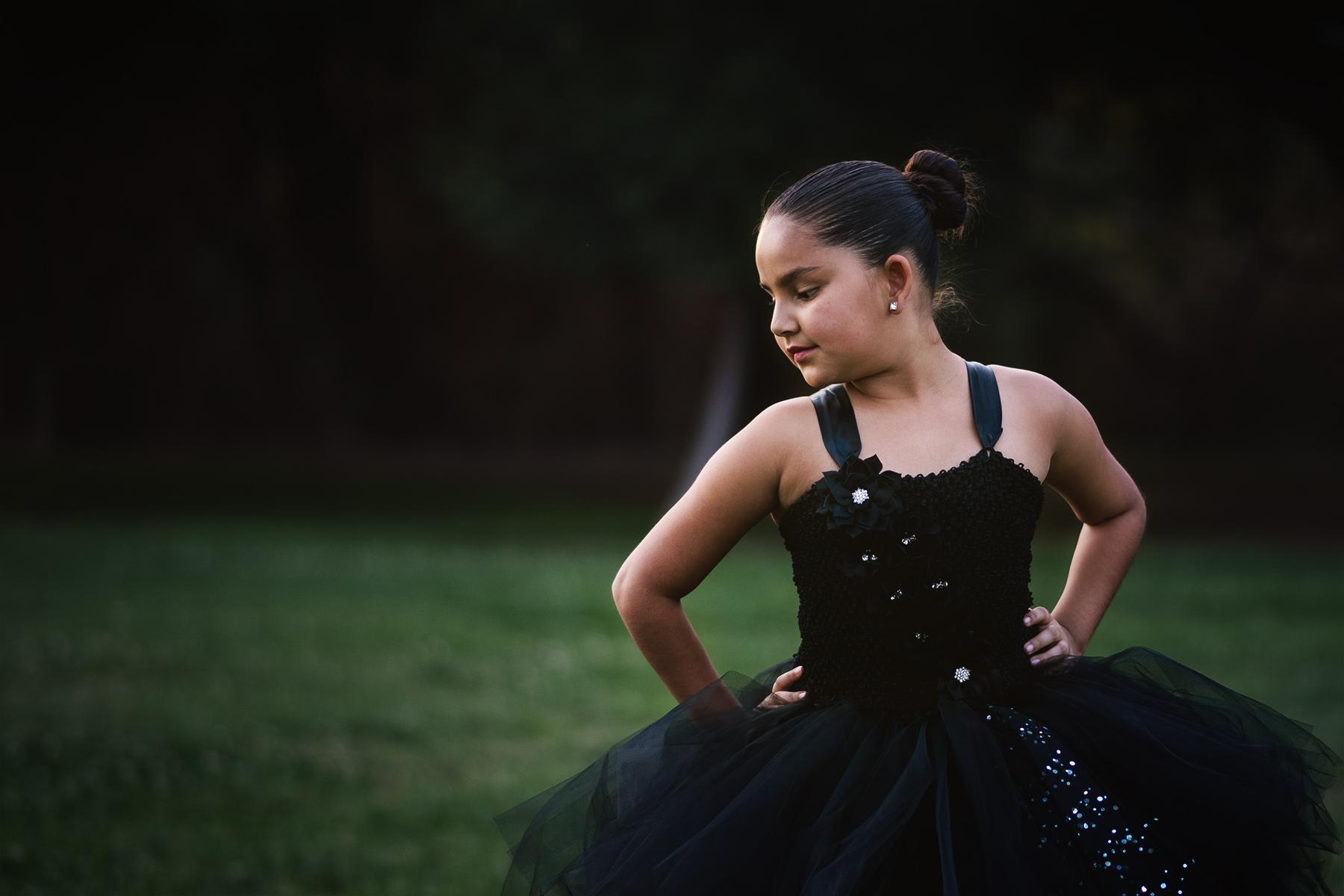 Front view of black tutu dress from Little Ladybug Tutus modeled by Miranda Sanchez