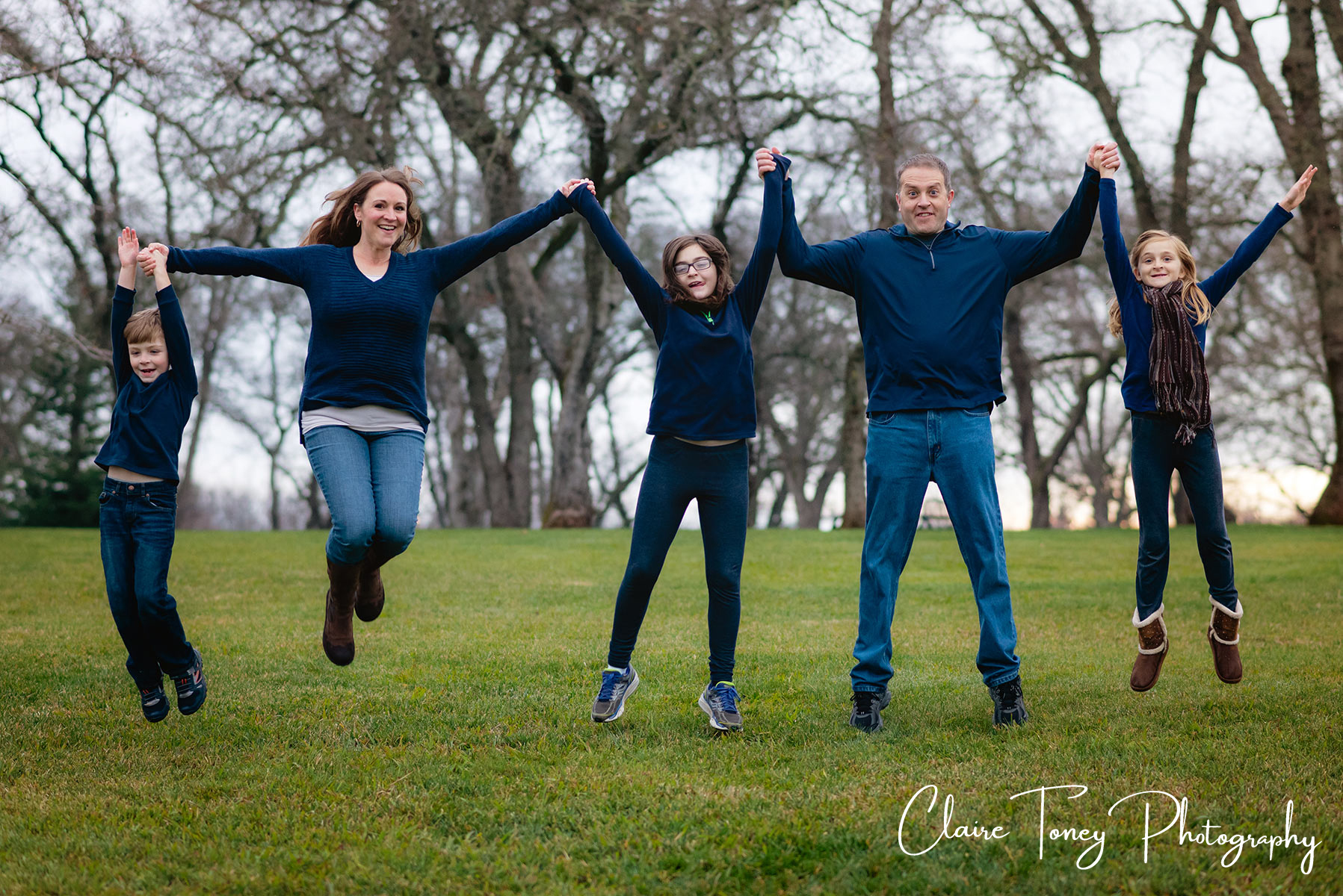 Family of 5 jumping