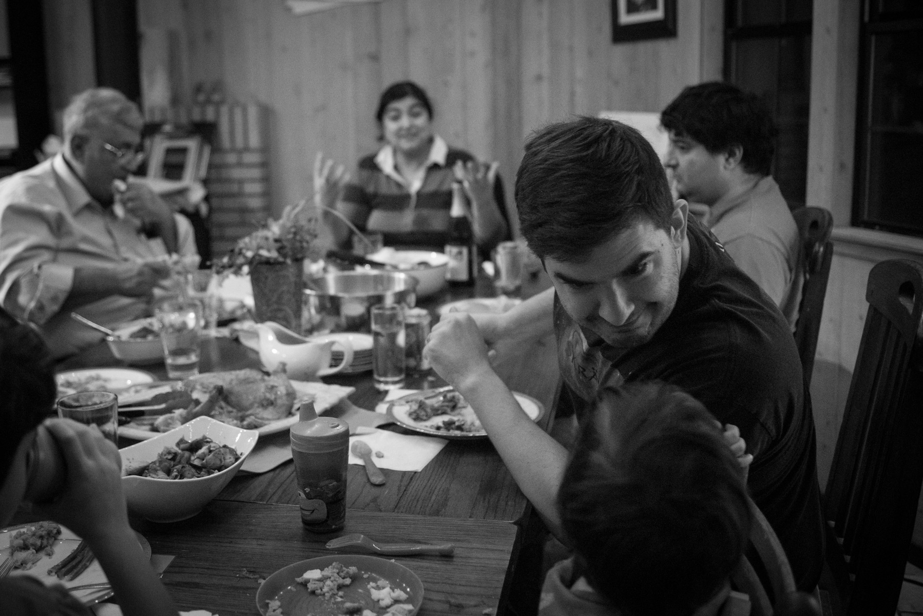 Dad playing with son at the dinner table