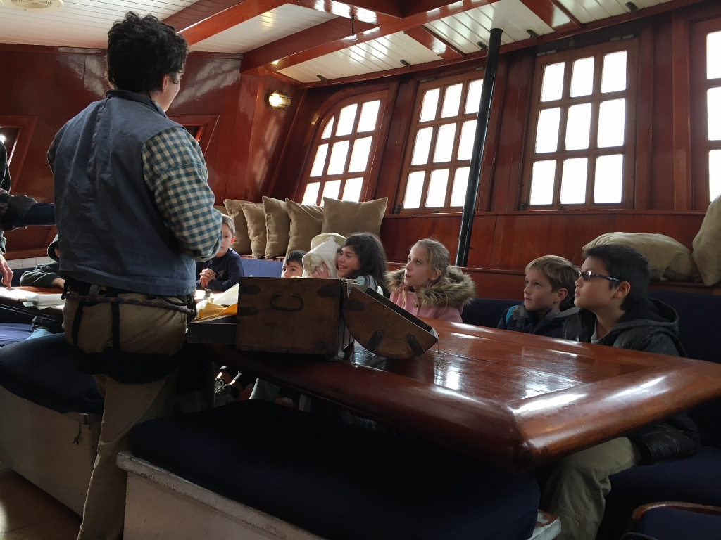 Children learning about 18th Century trading between America, China, Europe, and Native Americans onboard the Hawaiian Chieftain