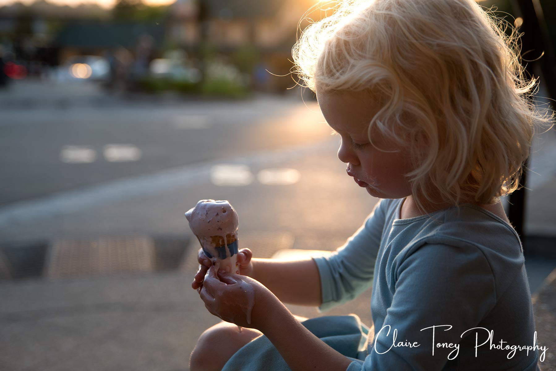 Child Portrait of a little girl holding a melting ice cream cone. Folsom CA. Claire Toney Photography
