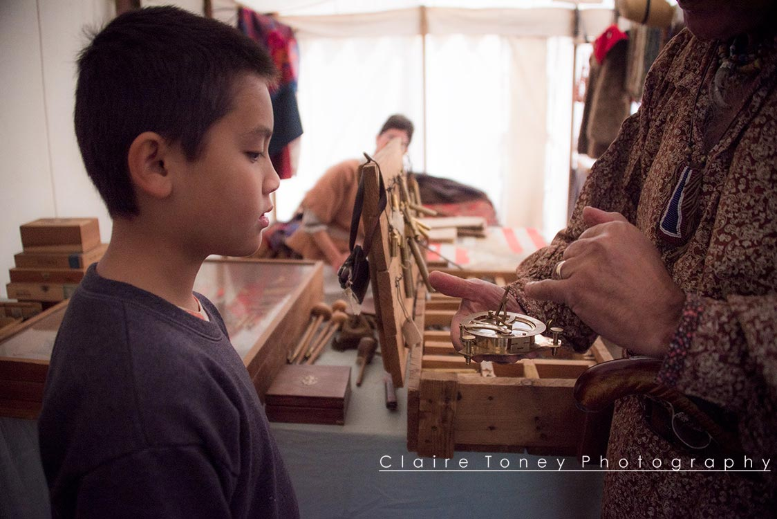 boy looking at a hand compass