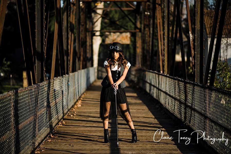 Teen steampunk styled photoshoot on an old metal bridge