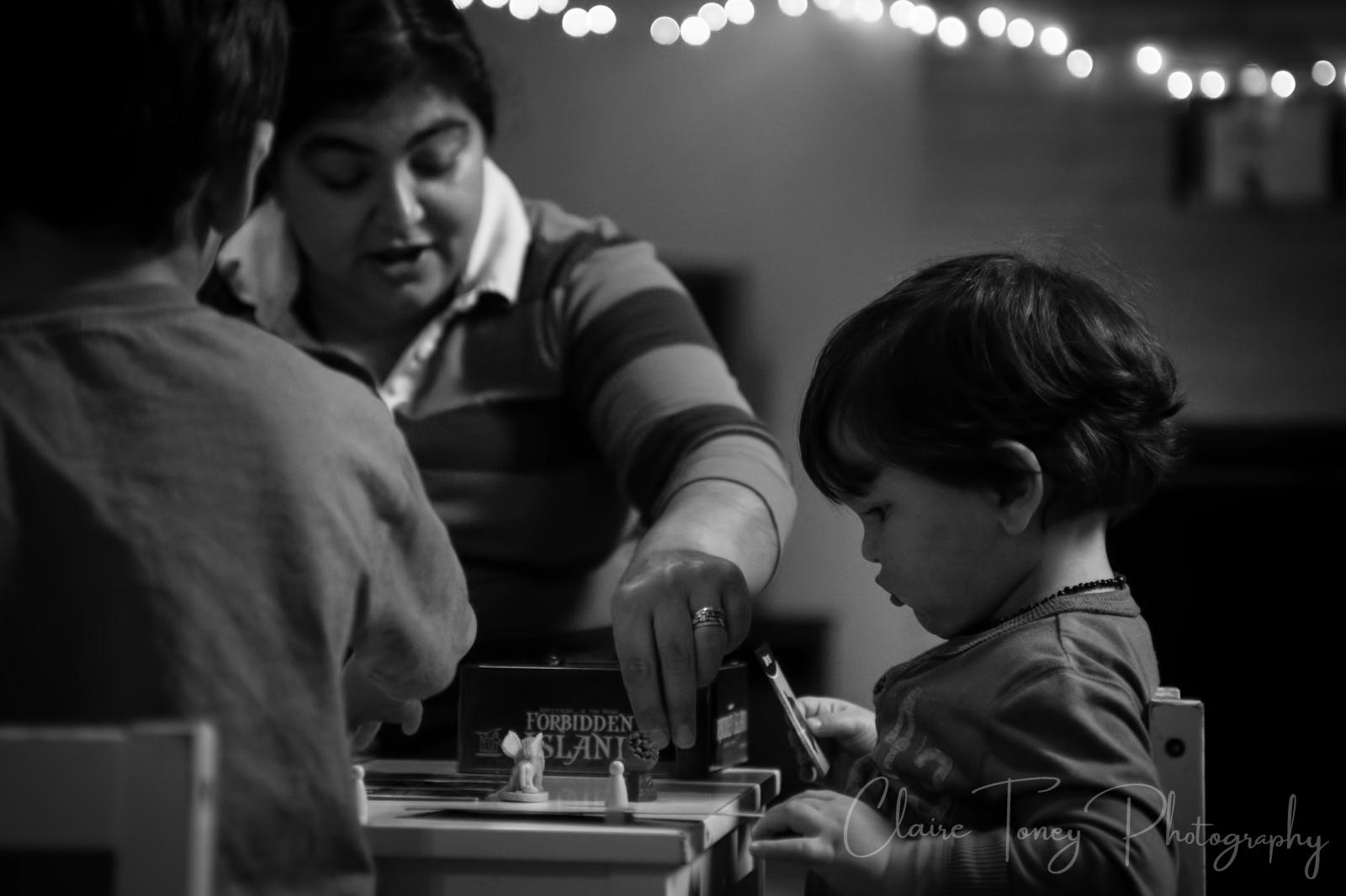 Little boy looking at a board game