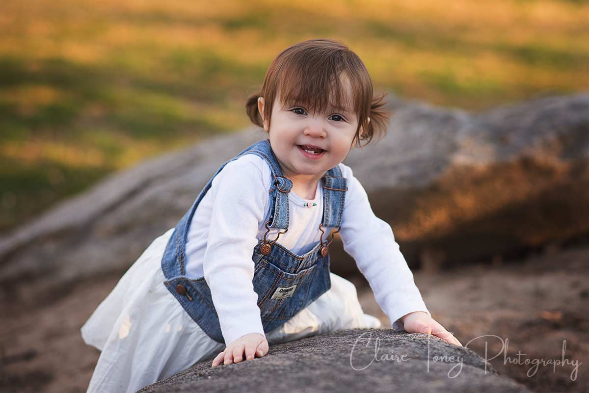 little girl climbing on rocks
