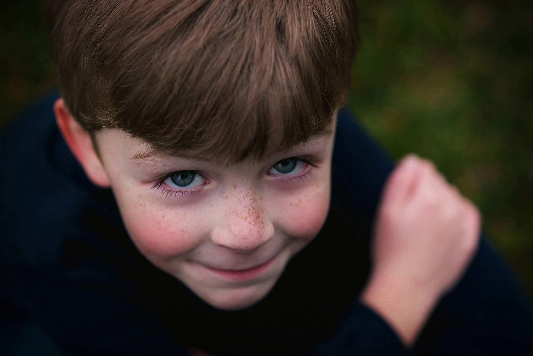 Young red-headed boy smiling at the camera