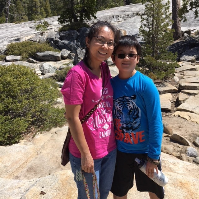 A mom in a pink shirt and her son wearing a blue shirt at the Pyramid Creek trailhead in Lake Tahoe