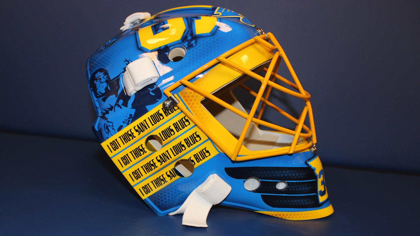 Jake Allen 2017-18 Mask - For Jake Allen's 2017-18 mask, we aimed to pay homage to the classic St. Louis Blues. With images of the classic Blues logo, Louis Armstrong, and lyrivs to classic blues songs, this simple yet sharp design creates a timeless look.