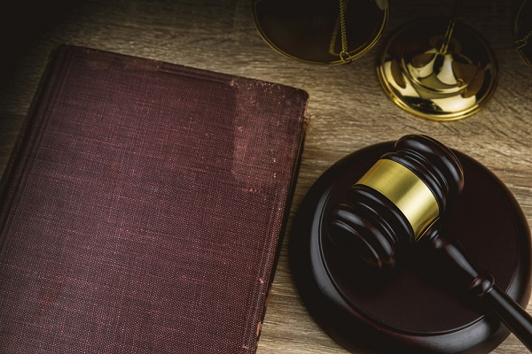 Judges gavel and a book on table