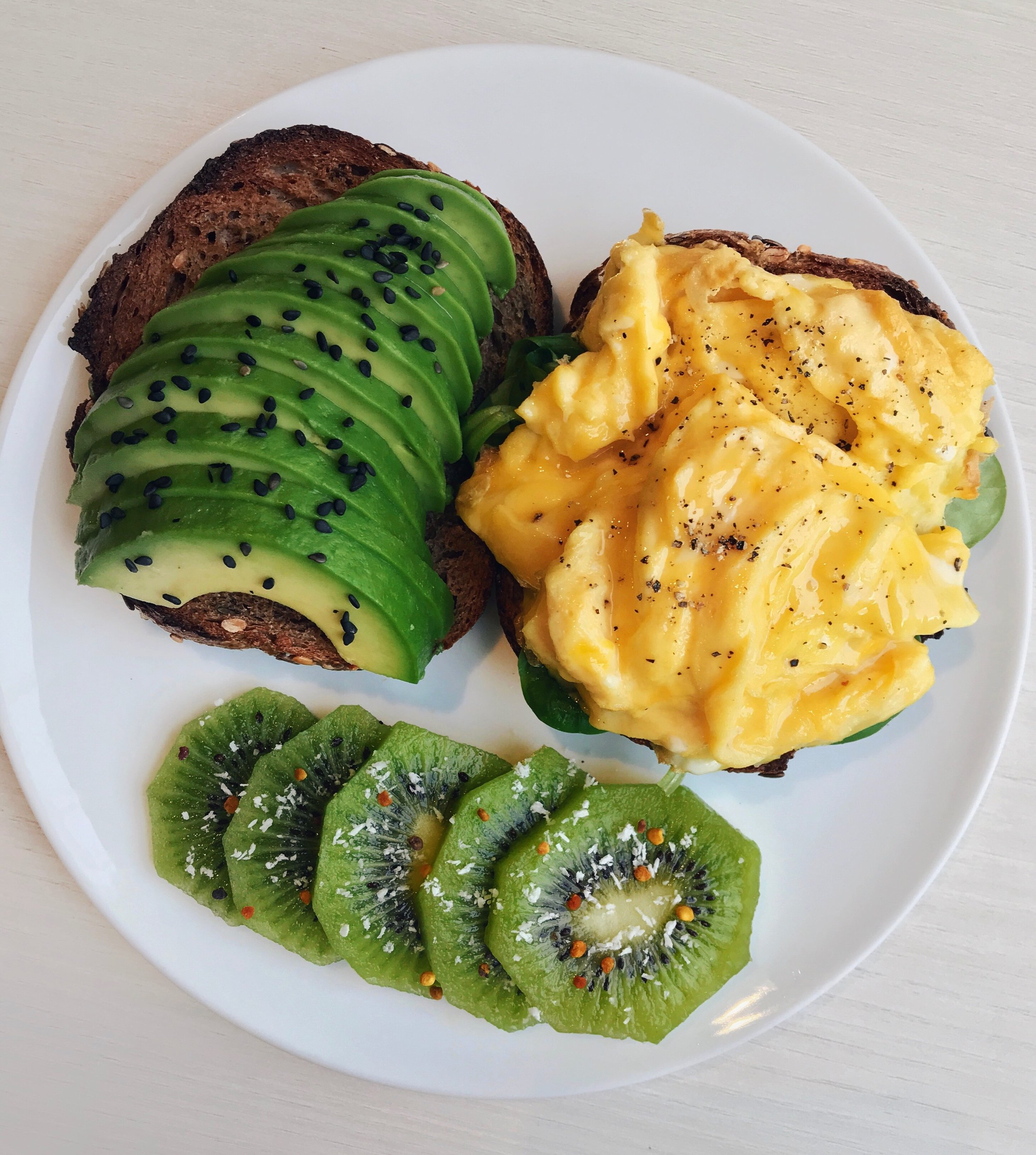 Avocado & Scrambled Eggs Toasts - On my Instagram account, I often got asked how to get fluffy scrambled eggs... There's absolutely nothing to add (no milk, cream or oil is needed)but just make sure you cook them according to the directions below.Tutorial: I first beat the eggs in a bowl with cracked black pepper until foamy, then I pour the preparation into a pan with olive/coconut oil on medium heat. I leave the eggs for about 10/15s without touching, then with a spatula I bring the batter to the center of the pan. I do this on repeat (leaving 5/10s each time) until the eggs are fully cooked. It's easy but the key is just not to over mix the preparation once in the pan.Hope this helps!