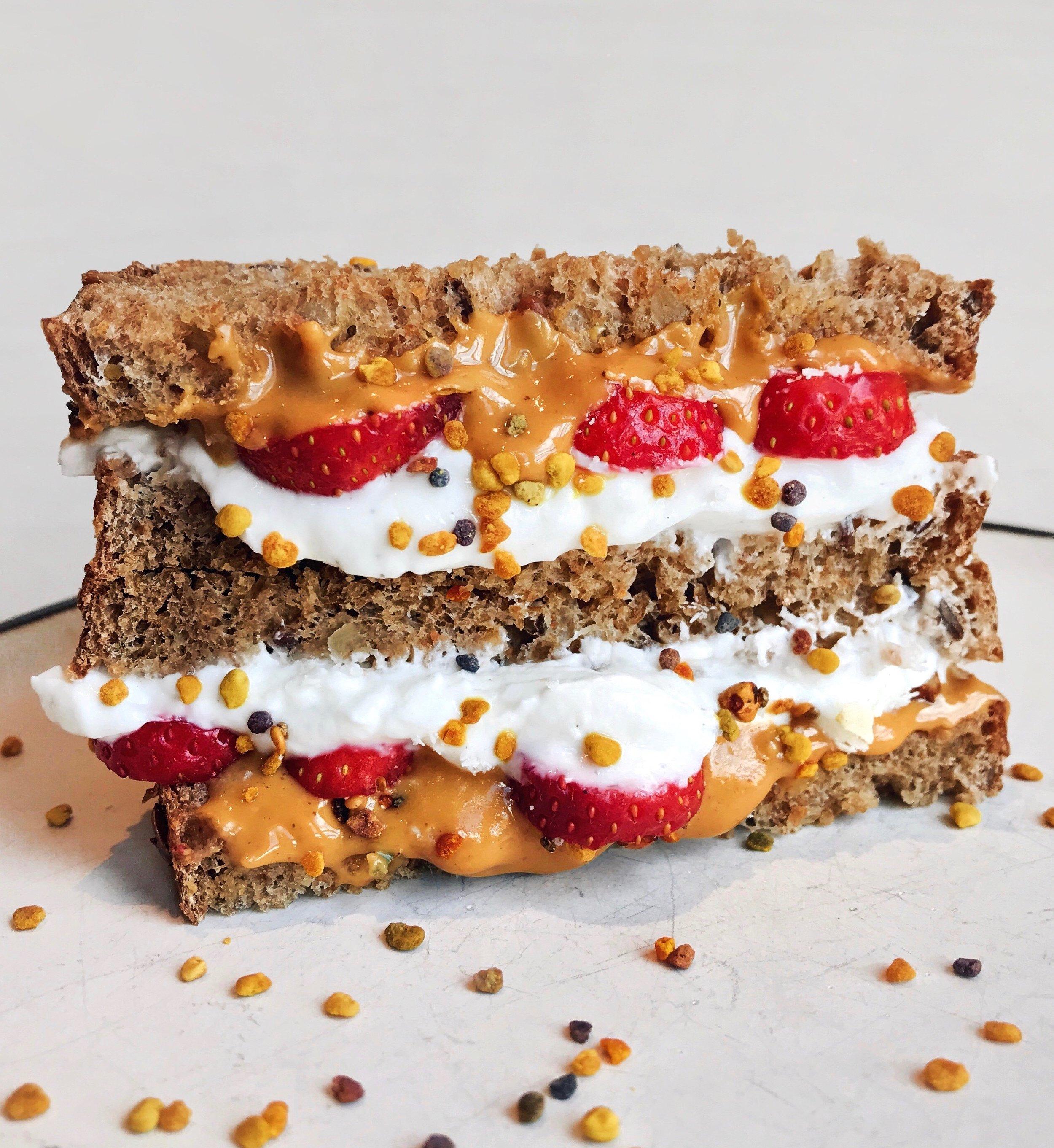 Creamy PB, Strawberry & Greek Yogurt Sammie - Toasted multigrain bread topped with @wild_friendspeanut butter +@driscollsberrystrawberries +@fagegreek yogurt +@koro_frbee pollen (you can use the code «werner » for a 5% online discount)