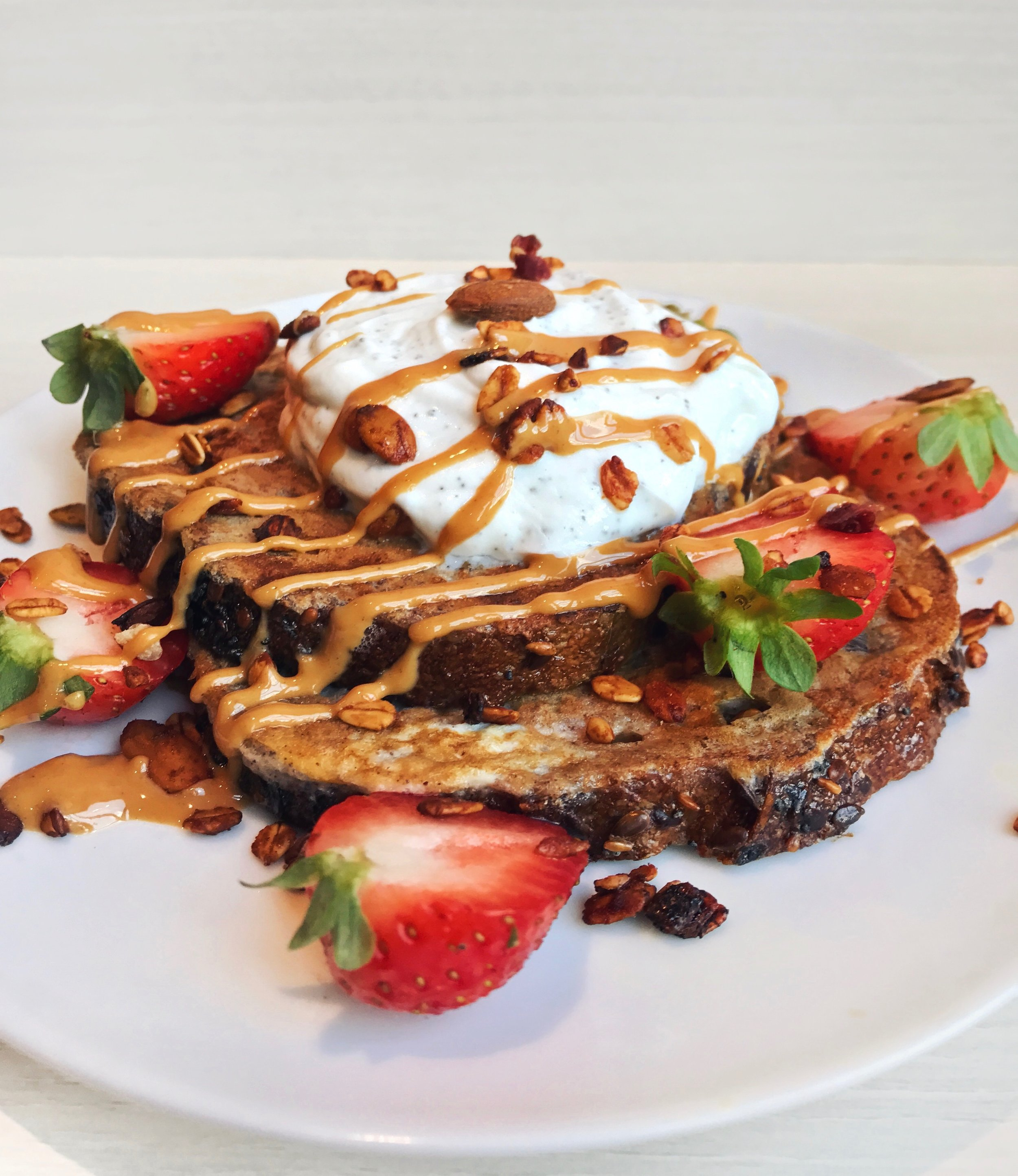 Strawberries,Peanut Butter & Cream French Toasts - - 1 egg-5 tbsp soy milk- a dash of cinnamon powder- a scoop of @vitalproteinscollagen peptides (optional)Mix all the ingredients together before dipping the bread in the mixture (leave 1min)and then grilling it in the pan with coconut oil. The grilling takes about 2min on each on medium heat.Toppings: strawberries +greek yogurt +@wild_friendspeanut butter drizzles +granola