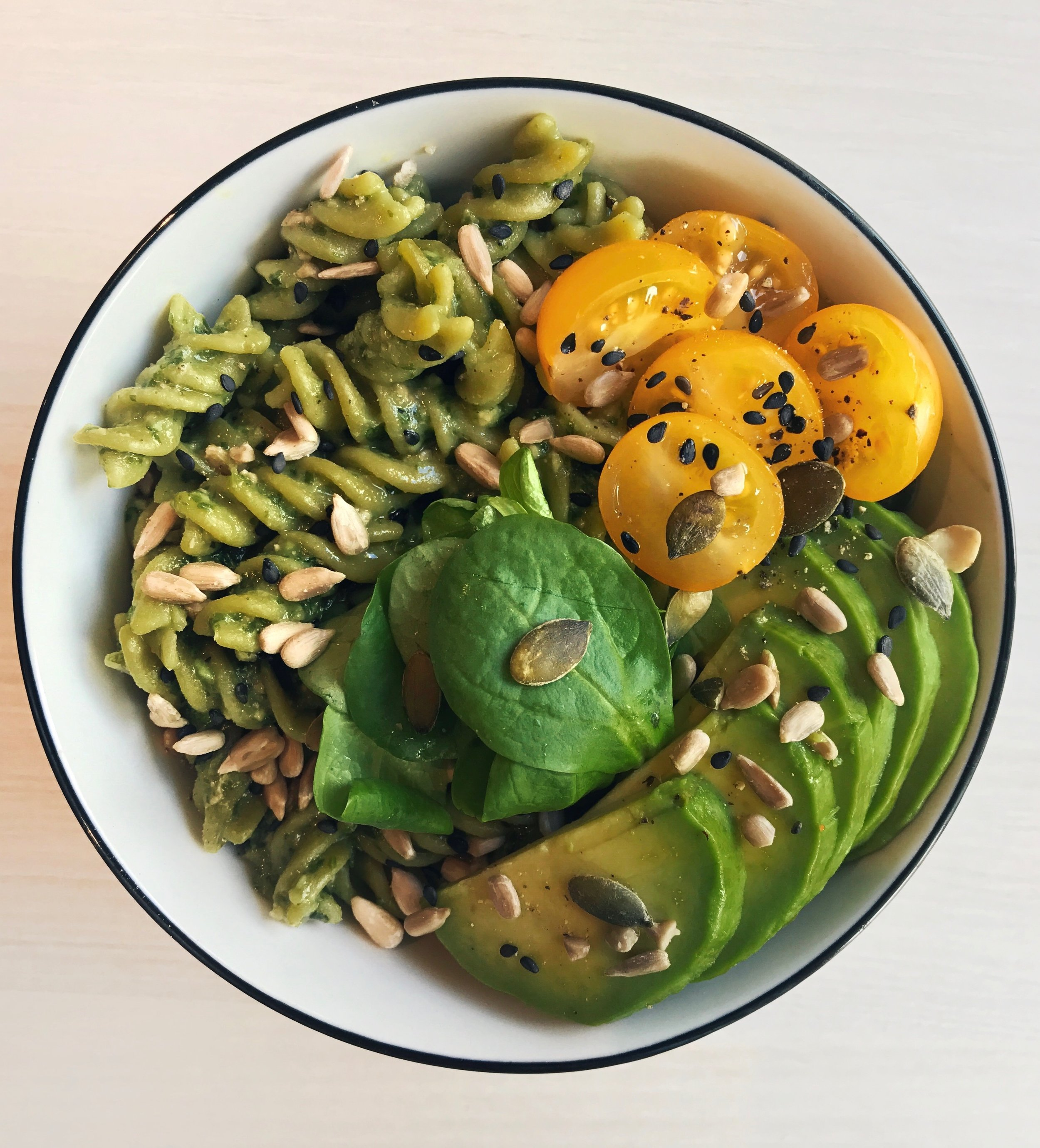 Creamy Avocado Pesto & Basil Pasta - For the sauce:- 1 cup basil-1 avocado-1 clove garlic (or sub with powder)-1/4 cup pine nuts-1/3 cup olive oil- A handful of cilantro- Salt/pepper to tasteMix all the ingredients together and blend until you get the desired consistency.Pour over pastas, stir a bit and top with nuts/seeds, avocado and cherry tomatoes.