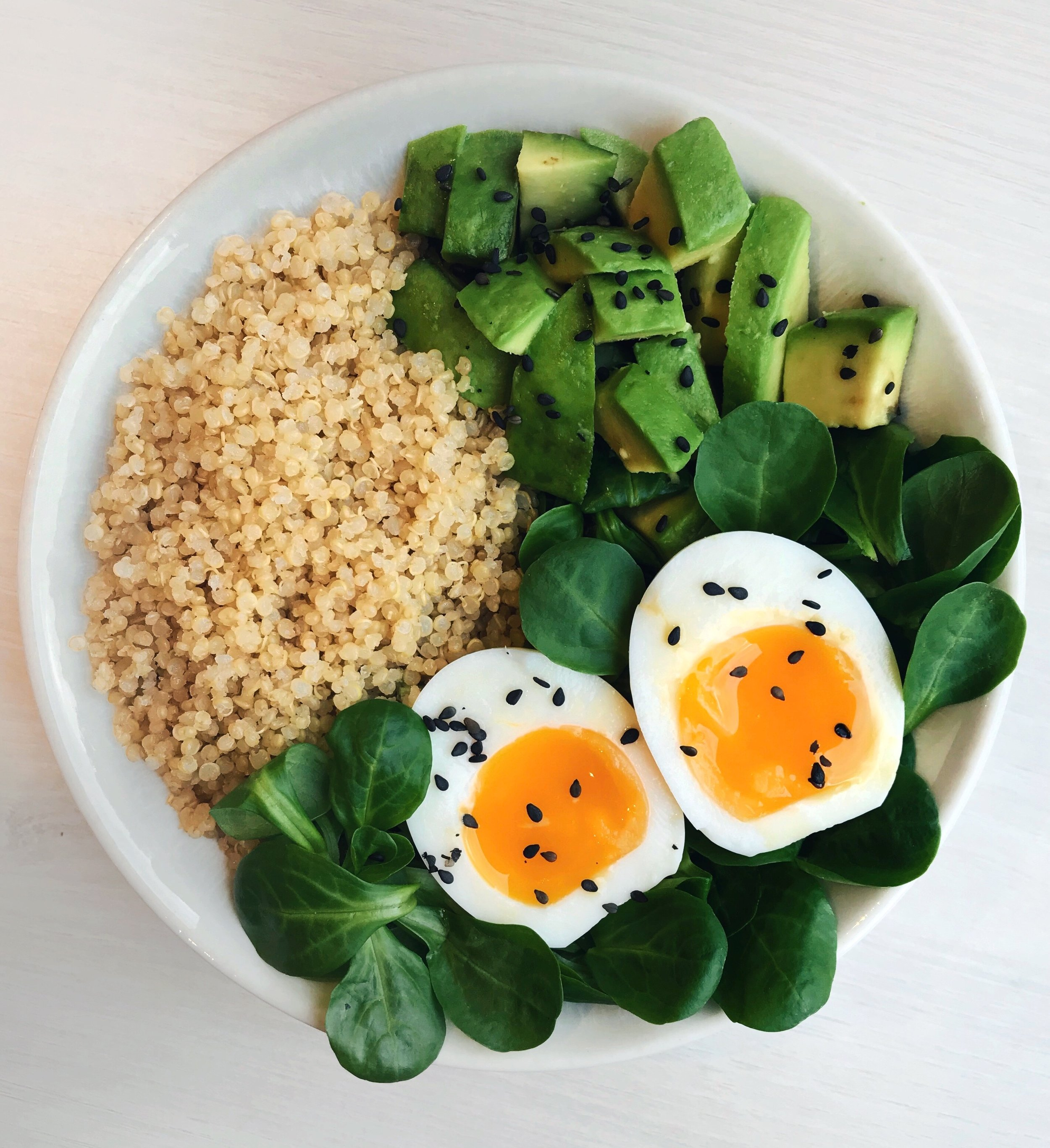 Quinoa, Avocado &Soft-boiled Egg Bowl - Salad leaves (seaoned with olive oil + lemon juice) topped with boiled white quinoa + soft-boiled egg (6min cooking) + black sesame seeds + avocado squares