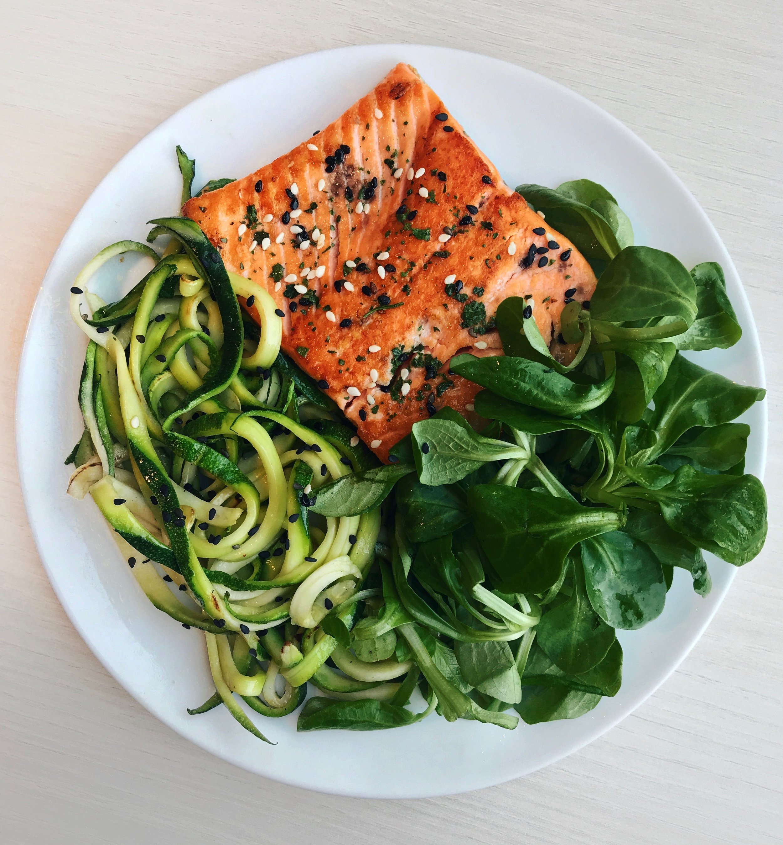 Sesame Grilled Salmon, Zoodles & Salad - Grilled salmon (cooked in olive oil for about 3mn on each side) + black and white sesame seeds + sauteed zoodles (just a few seconds in the pan on high heat with olive oil as well) + salad leavesQuick tip on cooking salmon: to get a crispy skin + golden color on the salmon, I recommend starting the cooking on high heat, and putting the non-skin part first. After 1min turn back on low/medium-heat, cook 2 extra minutes and flip + leave to stay for about 3min more.