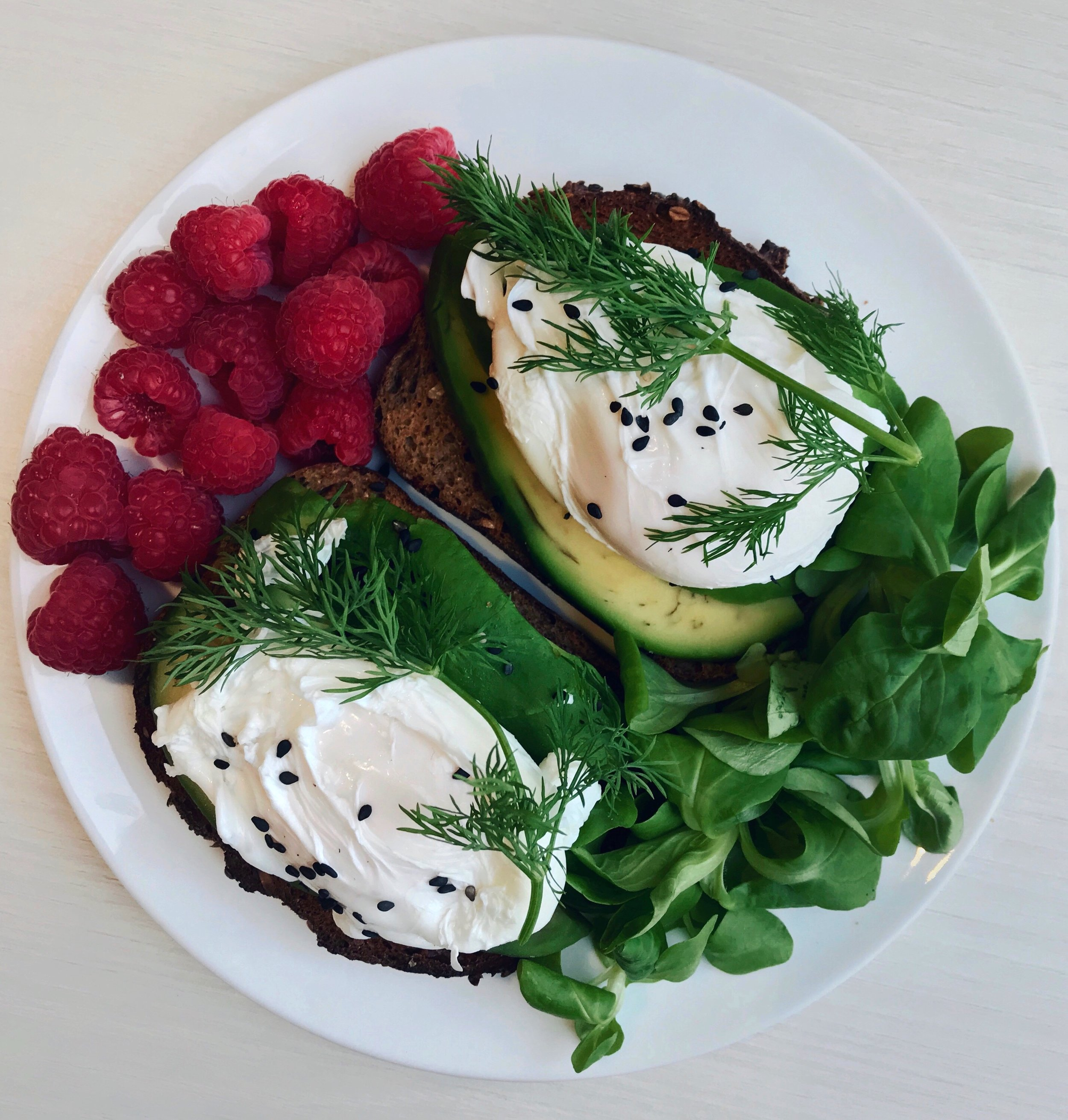 Avocado Toasts, Poached Eggs, Salad & Raspberries - Toasted nordic bread topped with avocado slices + poached eggs +@naturalia_magasins_biosesame seeds + dill +@driscollsberryfresh raspberries +@florette_francesalad leaves