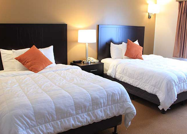 Traditional guest rooms: - The traditional rooms are large hotel rooms with two doubles or queen beds and a small sitting area. The bathroom has a tub/shower combo.Maximum occupancy is 5 people.Main hotel and Adjacent buildings.
