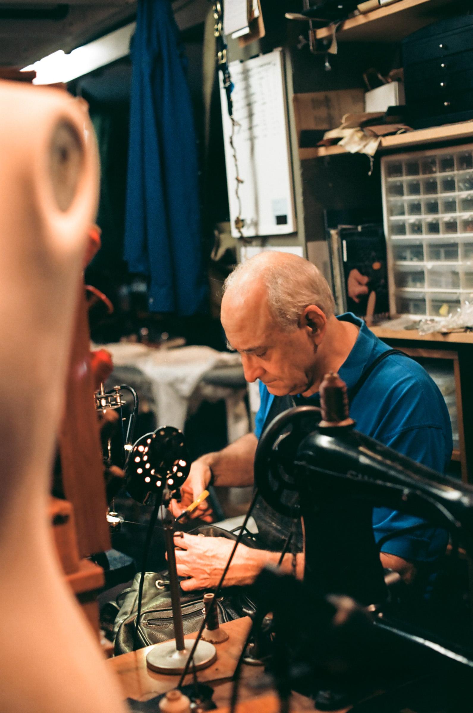 Tailor tailoring at Al's Attire.