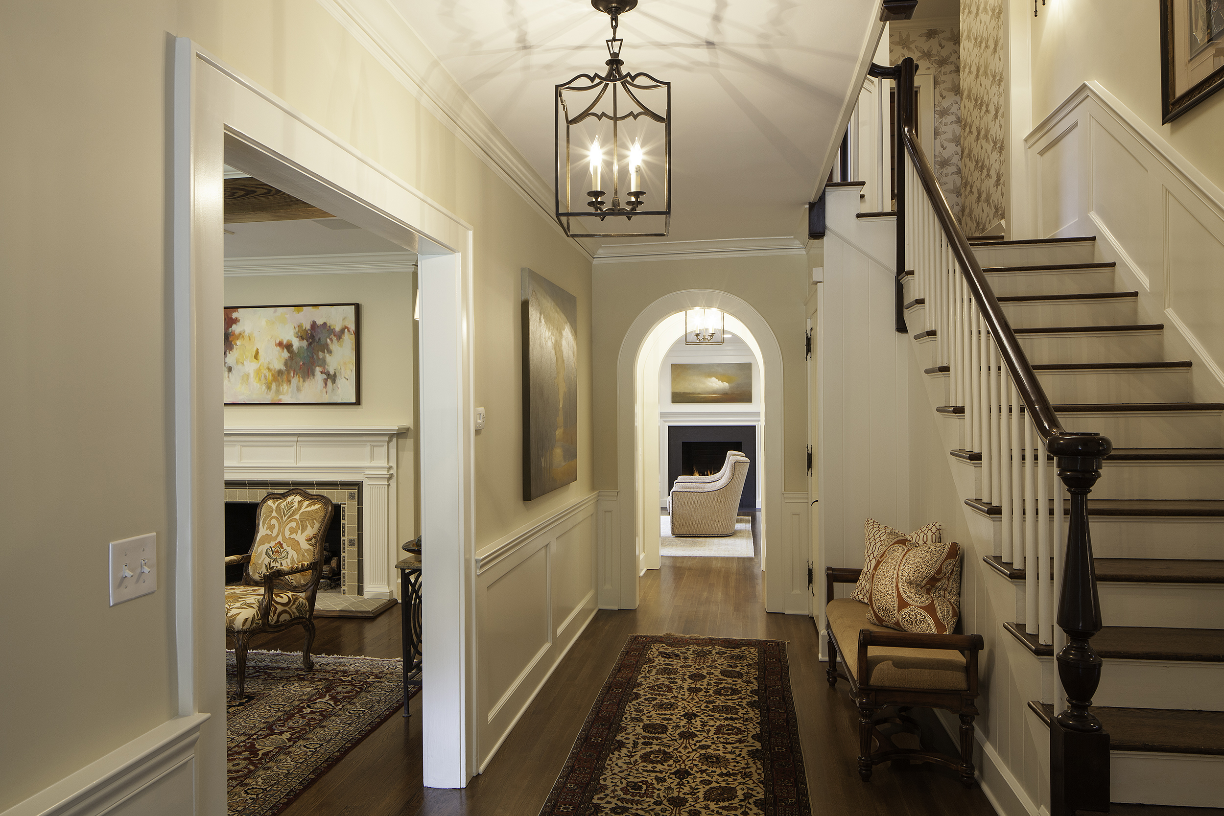 Stairway hall after renovation, with new moldings and trim detail.  Interior Furnishings by Ashlee Anthony Design
