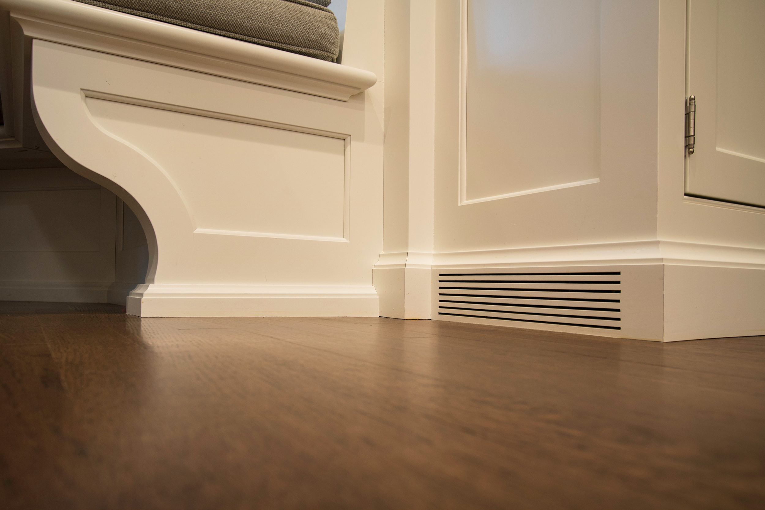 Integrated air return vent at base of cabinetry