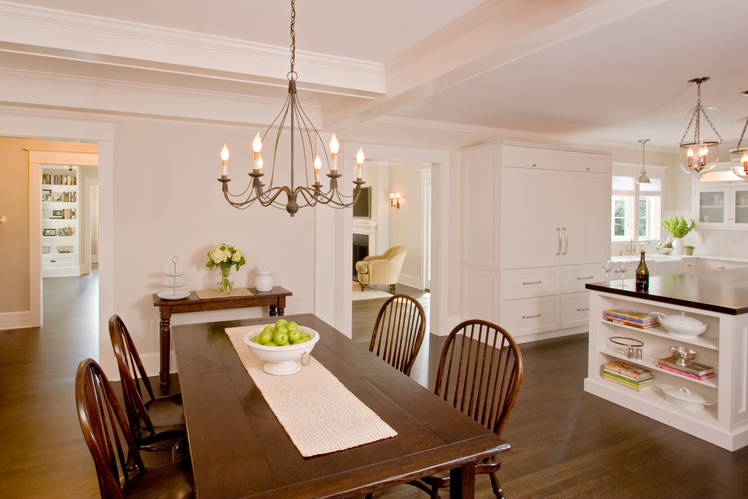 Eat-in-kitchen featuring beamed ceiling and white cabinetry