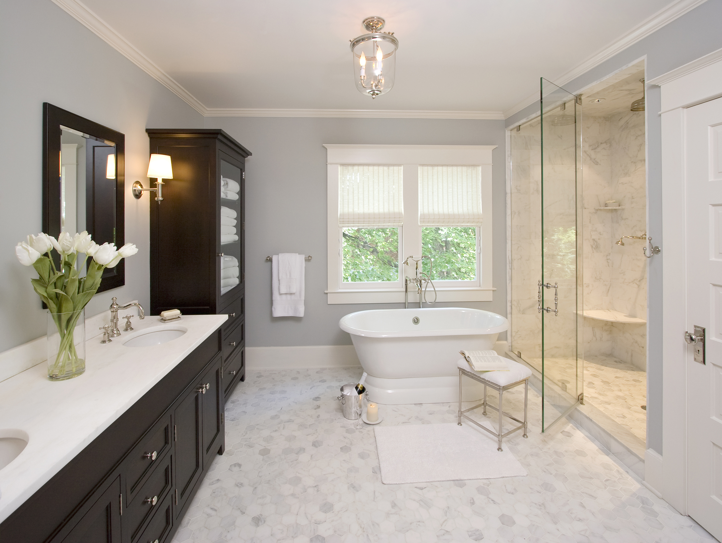 Master Bathroom is a Houzz.com favorite with over 120K saves and everyone asking what color is that on the wall!