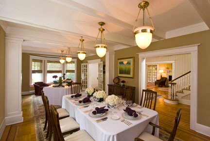 The Multiple lights hung closer to the ceiling gives the room more flexibility for entertaining