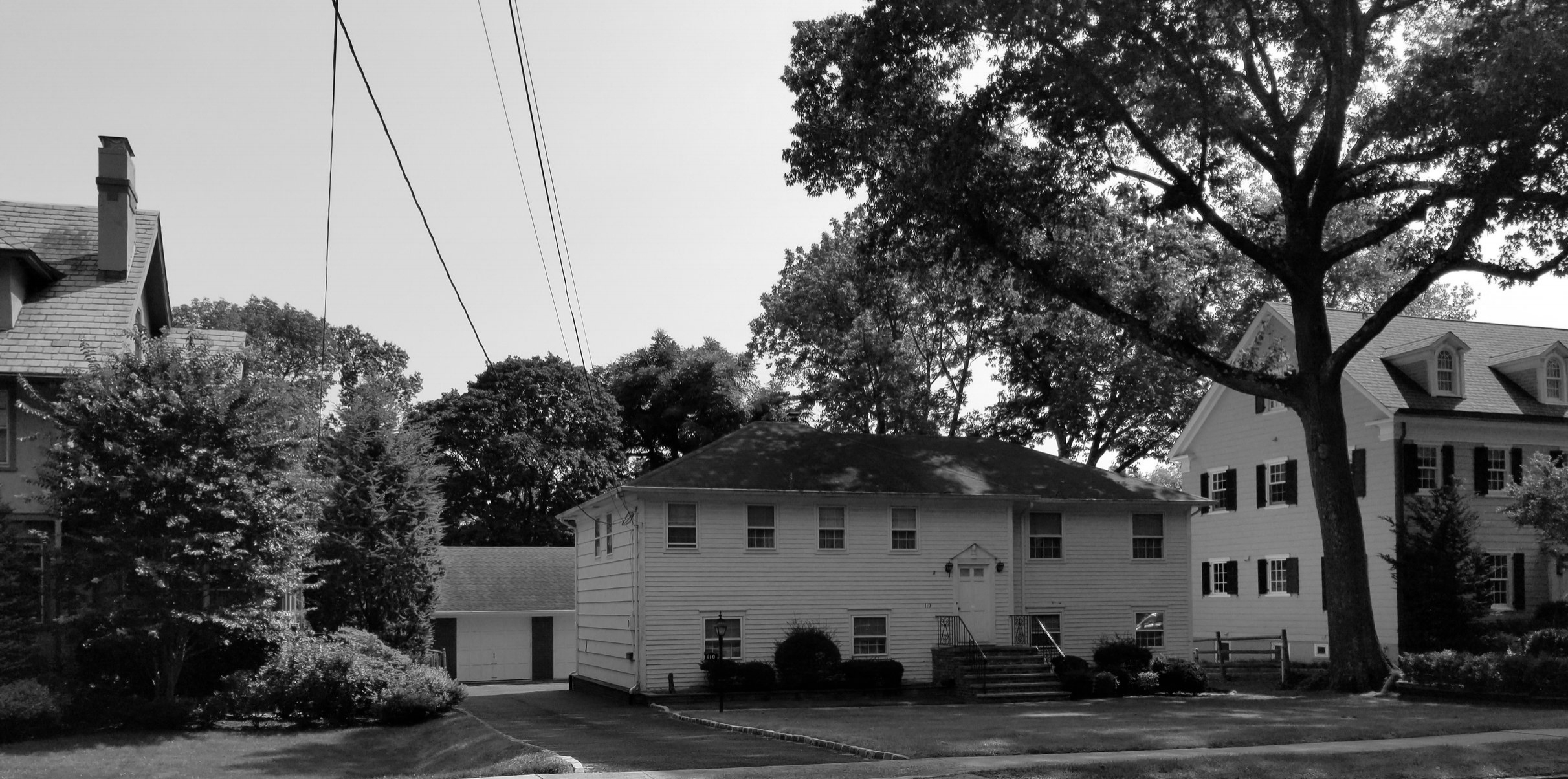 Before image. Existing home out of scale with the other period homes on the block. Existing home had no basement and did not meet the standards of today's living style.