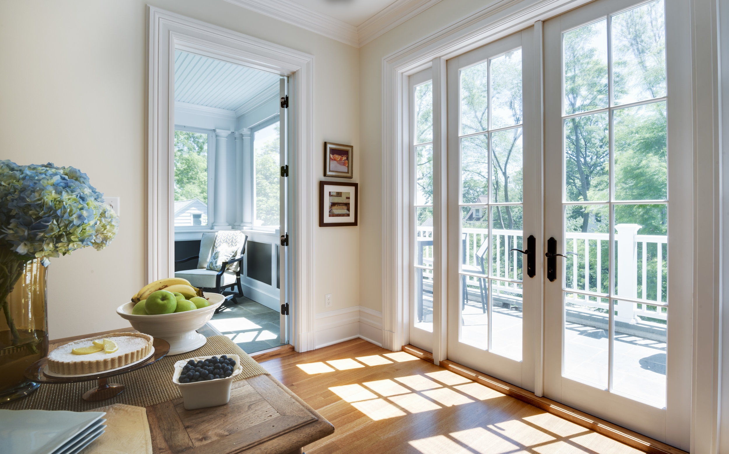 Casual Dining off the renovated kitchen with access to the terrace and screened porch. Natural light pours in.