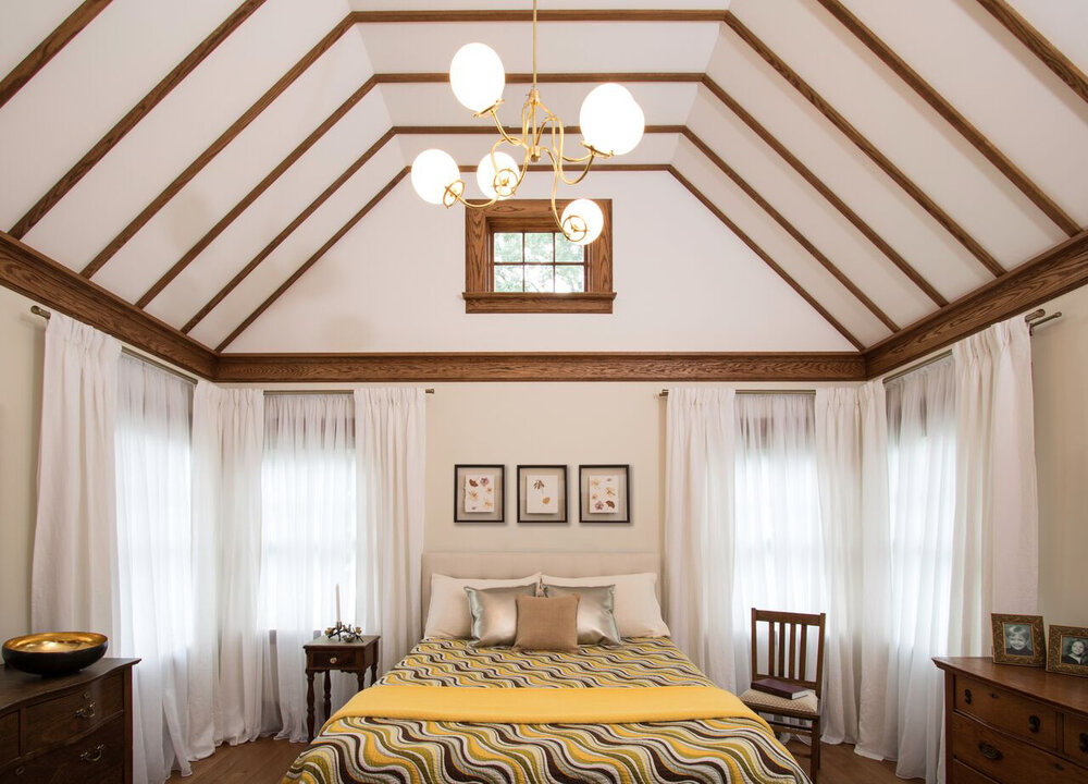 The Master Suite features soaring ceilings and six windows in all. With view of the sun rise in the morning and moon in the evening. The natural wood trim is consistent with the existing trim details in the rest of the home.