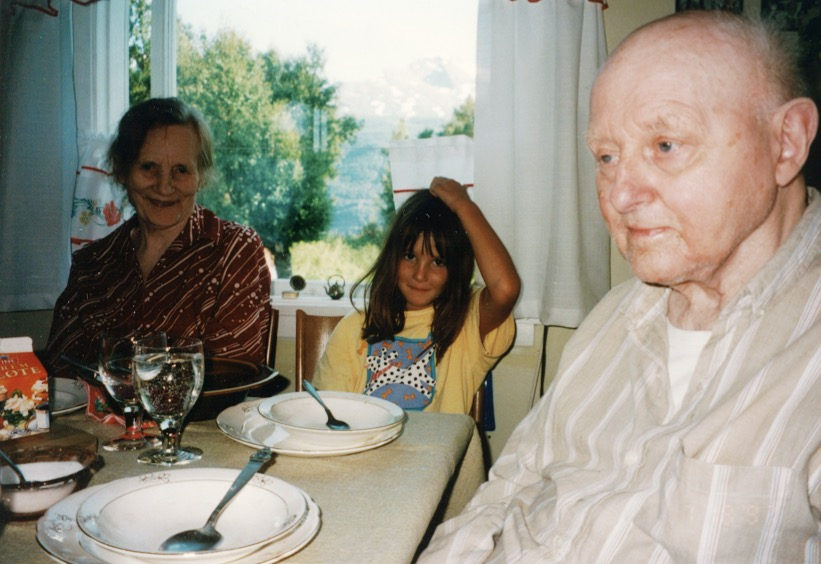 Me (age 6) with my great-grandparents sitting at their kitchen table in Øyjord, Norway.