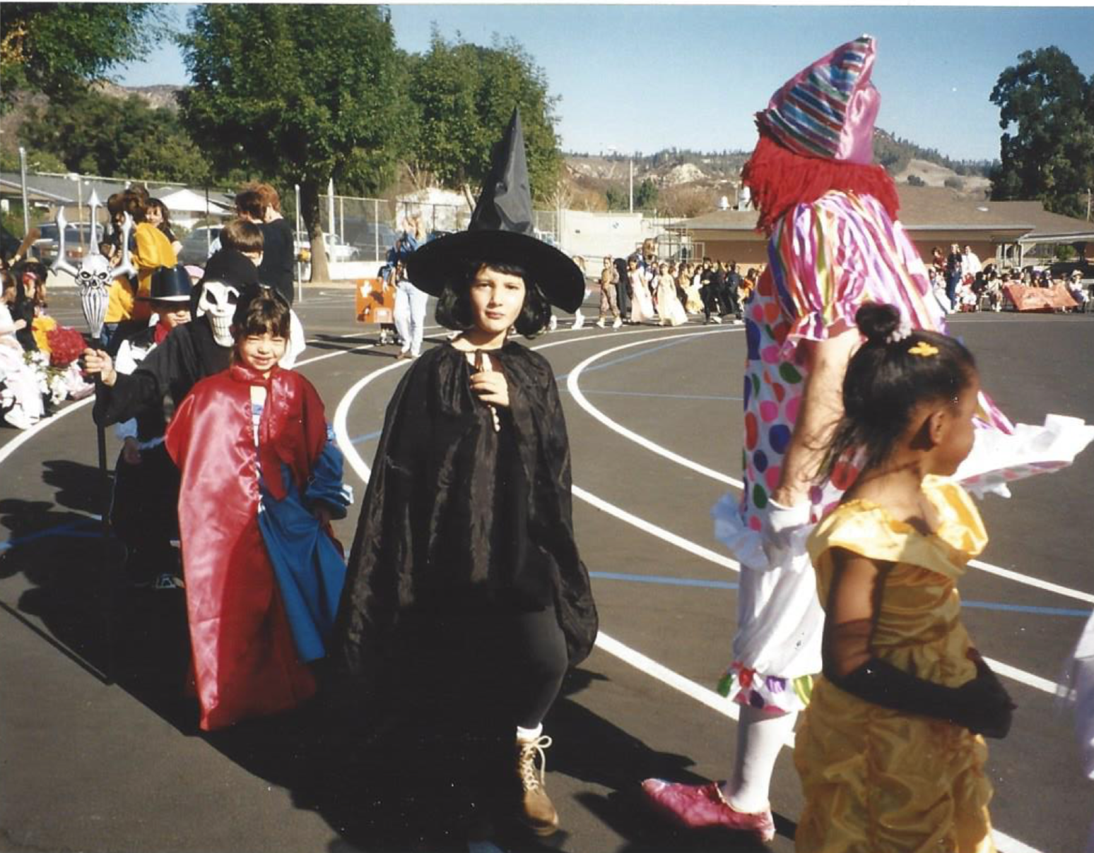 (Me dressed as a witch in 1st grade Halloween parade, 1997)