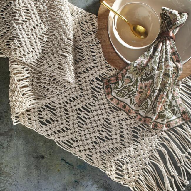 Natural Macrame Table Runner - Intricately hand knotted by Indian artisans using 100% cotton, our exclusive natural macrame runner with long tassels adds bohemian flair to the table from World Market.
