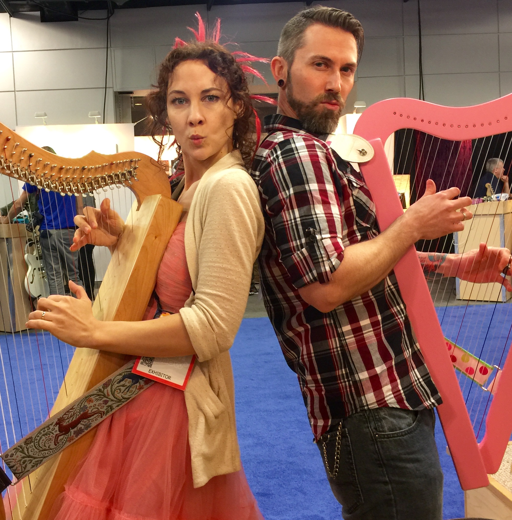 Camille Fournier & Garen Rees are VERY serious as they demonstrate Harpsicle® Harps at NAMM.