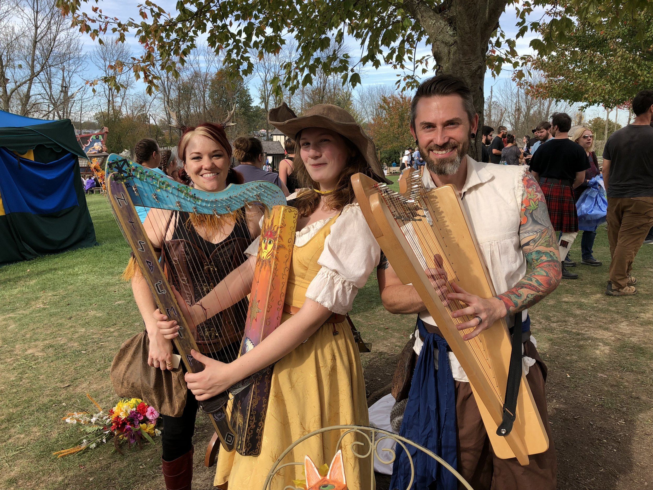 Melissa Irwin, Lilu Stocker & Garen Rees at the Ohio Renaissance Fair. Lilu decorated her Sharpsicle™ Harp herself!