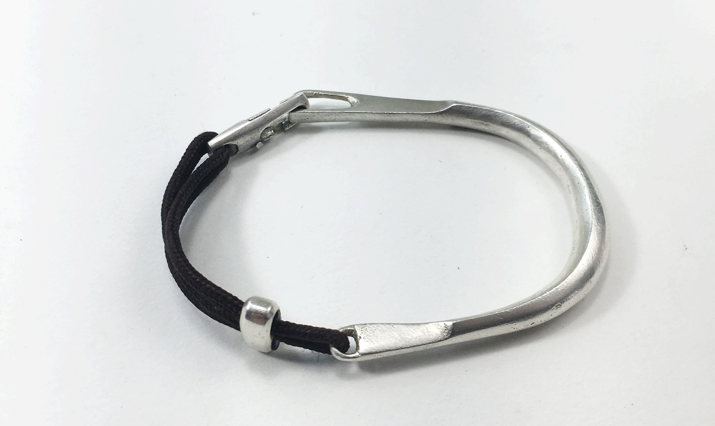 Heavy Clasp Bracelet  silver on brown cord  $223