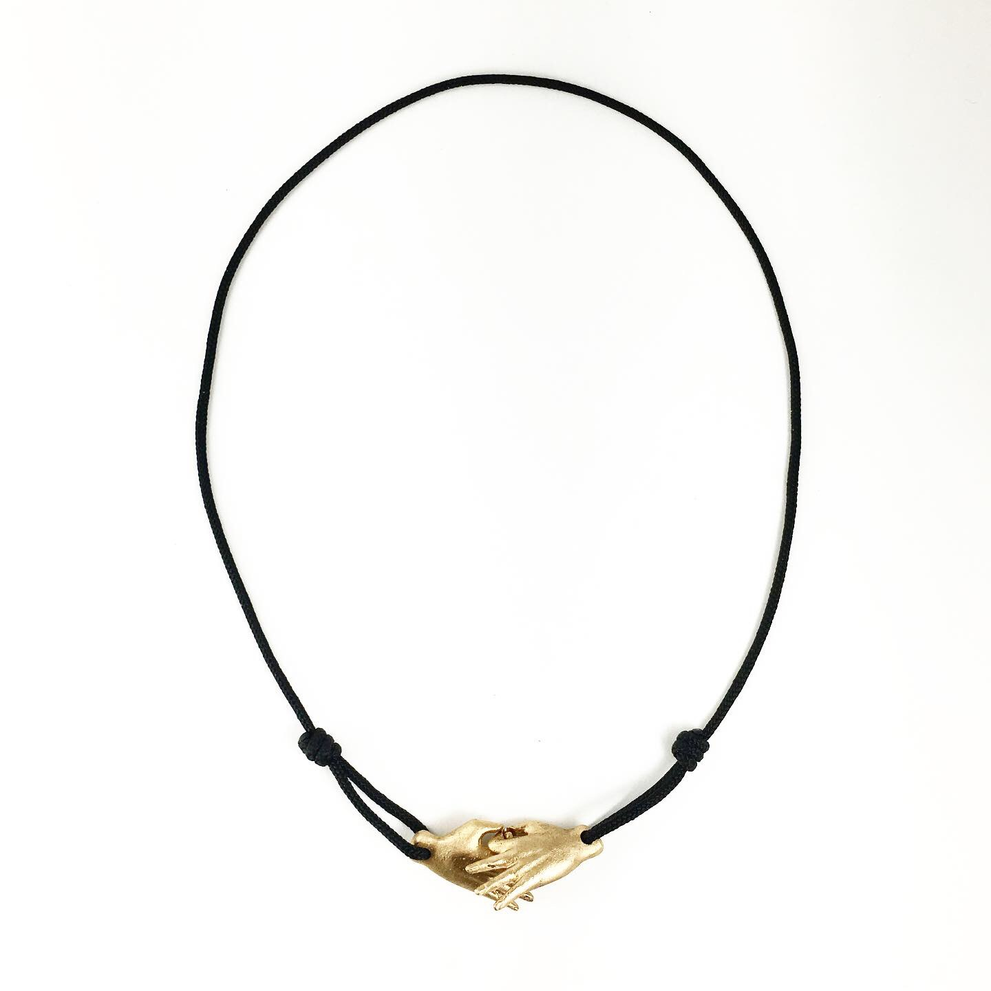 Hand Clasp Necklace  bronze on black cord  $83